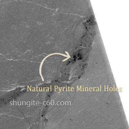 surface shungite and natural pyrite holes on stone