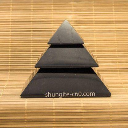 Segmented shungite stone pyramid