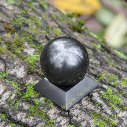 shungite sphere on a square stand