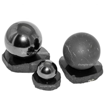 shungite ball polished and unpolished on a stand