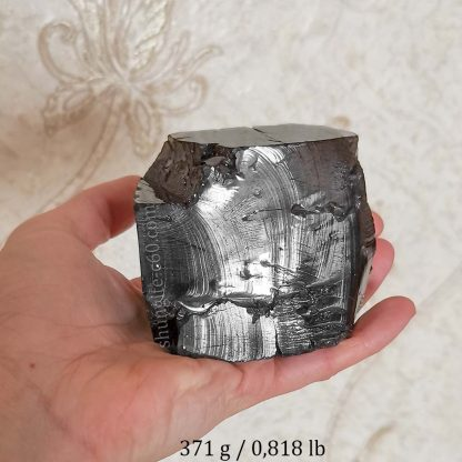 shungite type 1 lot 1 On the hand