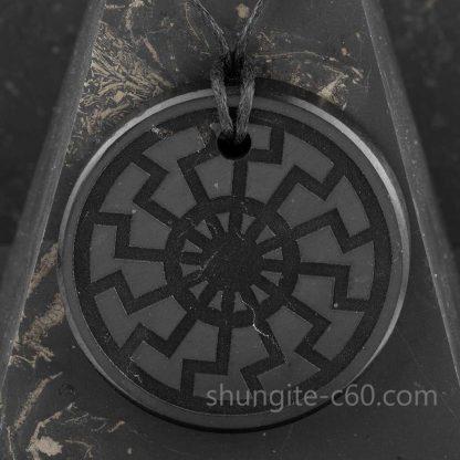 Black Sun pendant made of rare stone