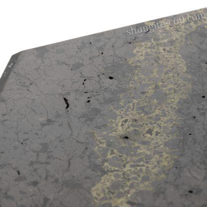 shungite rock polished surface and holes