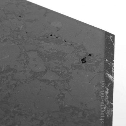 shungite stone polished surface enlarged image