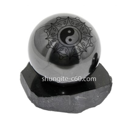 Shungite ball from Karelia with engraved Feng Shui