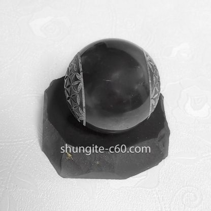 black sphere with engraved flower of life on both sides