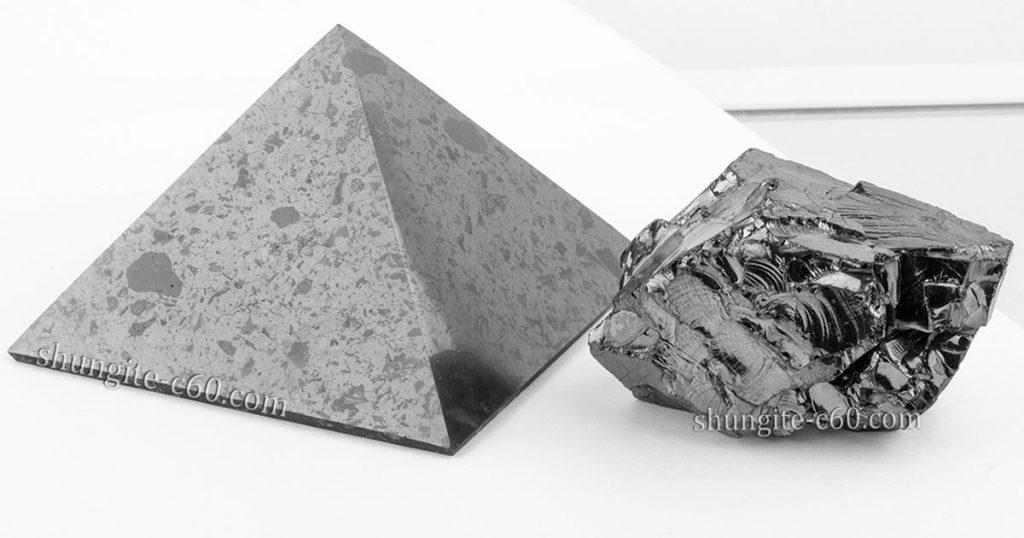 Polished shungite pyramid vs elite shungite stone