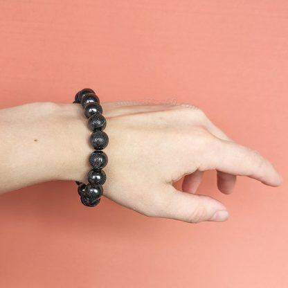 shungite Flower of Life bracelet beads on a hand